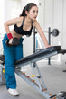 Young woman sport fitness lifting dumbbell, workout in fitness gym