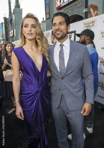 Cast members Heard and Rodriguez pose at the premiere of