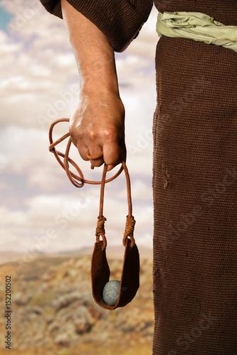 Vászonkép Hand of David Holding Slingshot