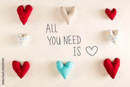 Photo  All You Need Is Love message with blue heart cushions