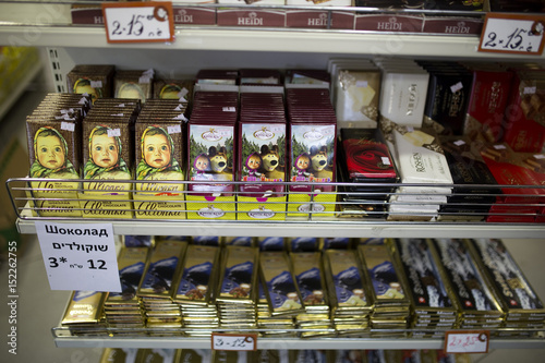 Chocolate bars are displayed for sale on shelves at a Russian deli