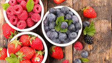 Strawberry,blueberry And Raspberry On Wood Background