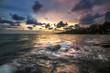 waves crash rock in the sea