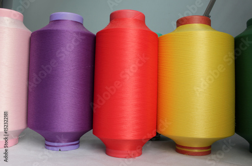 Fotografia, Obraz  color elastic thread in the production of knitwear