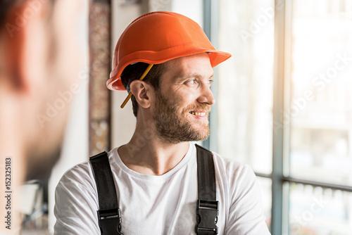 Happy smiling constructor wearing helmet