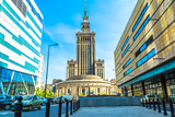 Palace of culture and science in Warsaw on sunny day with blue sky and green trees.  - 152330798
