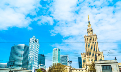 Panorama of Warsaw with modern skyscrapers on a sunny day with a blue sky overlooking the Palace of Culture