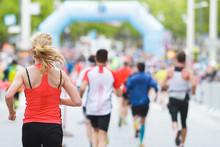 Woman Running At Marathon At S...