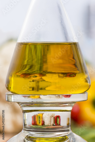 Photo Stands Kitchen Olive oil bottle in the kitchen with magnification of vegetables