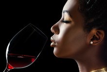 African Woman Smelling Red Wine Aroma.