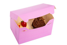 Two Cupcakes Are In The Delivery Box Over White Background