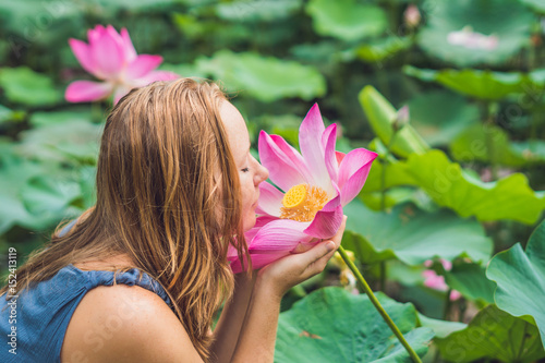 picture of beautiful Red-haired woman with lotus flower in hand