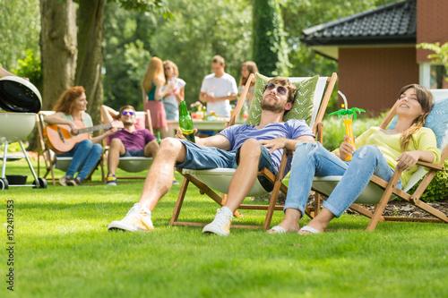 Couple sunbathing in the garden