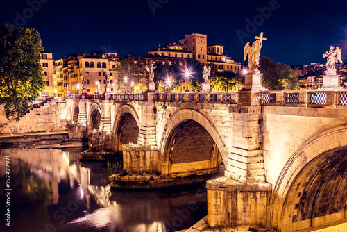 the-famous-ponte-vittorio-emanuele-ii-leading-to-st-angelo-castle-at-night-rome-italy