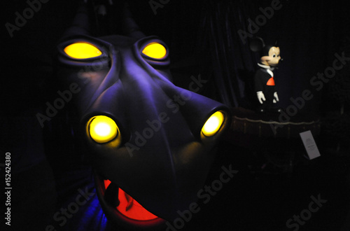 A Maleficent Dragon Head And Mickey Mouse Audio Animatronics