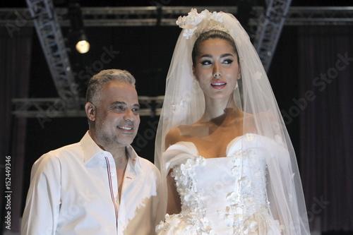 A Model Displays Wedding Dress By Lebanese Designer Abed Mahfouz During Spring Summer 2015