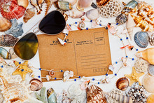 Mediterranean Styled Still Life With Vintage Postcard, Sunglasses And Sea Shells