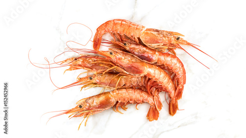 Raw shrimps on white marble table with copyspace