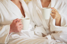 Couple In White Bathrobes In B...