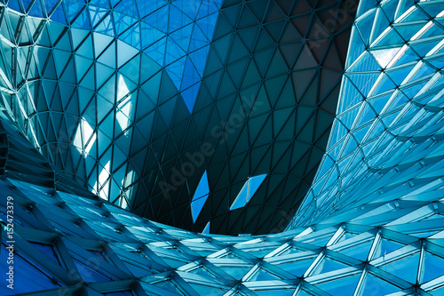 Garden Poster City building Structural glass facade of modern office building. Abstract architecture fragment.