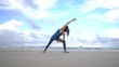 Woman is making yoga pose on beach in Vietnam. Sea or ocean happy female relaxation. Water and waves. Hands and blue sky. Exercises calmness and harmony.