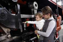 Child Touching Locomotive