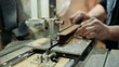 Luthier forms a billiard cue running on a band saw.