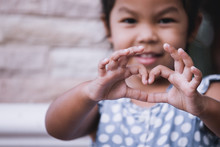 Asian Little Girl Making Heart Shape With Hands In Vintage Color Tone