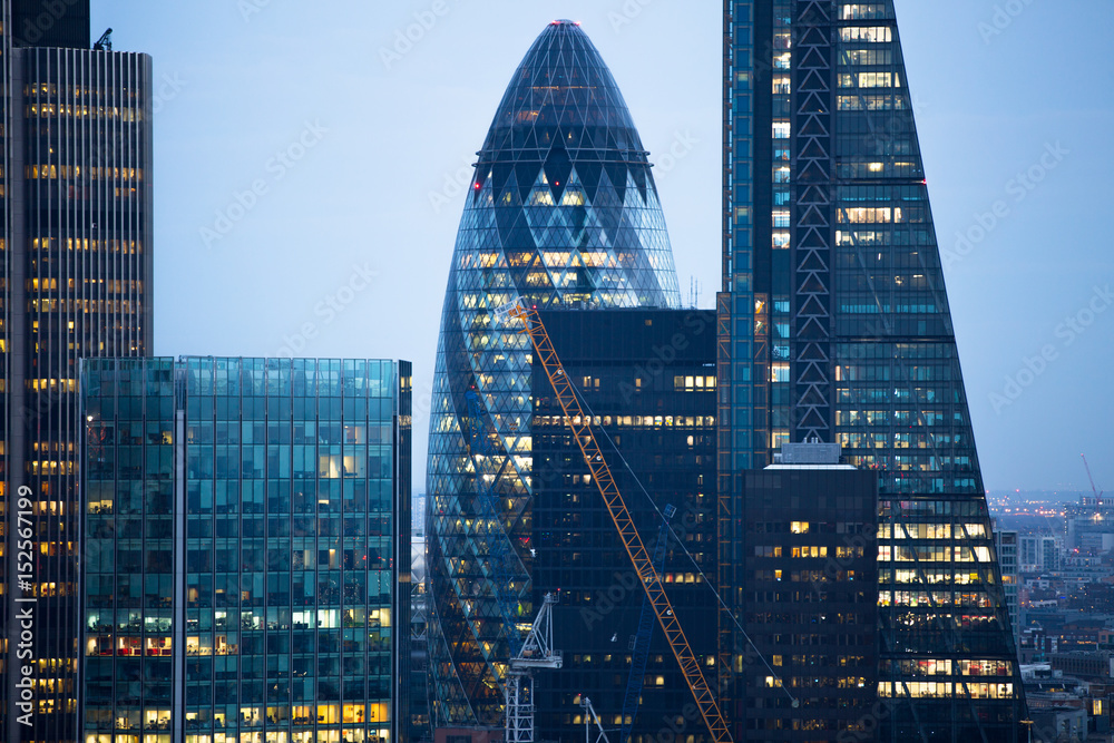 Fototapeta City of London business aria view at sunset. City of London the leading financial centre in the Europe.