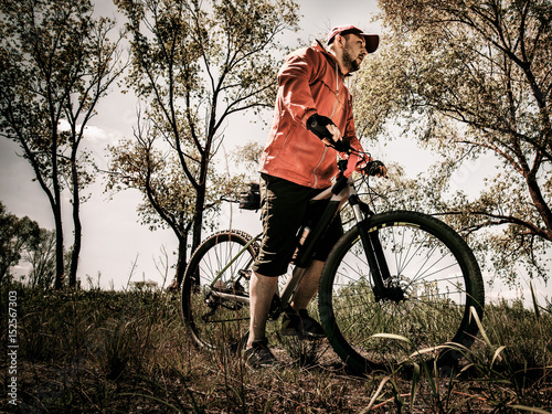 Ryder sitting on a mountain bicycle ride on off-road Wallpaper Mural
