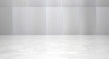 Empty Room With Metal Wall Panels And Polished Marble Floor