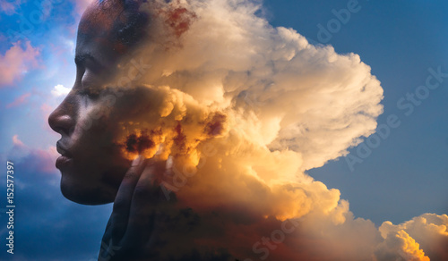 Double exposure, portrait of a dark-skinned woman and a striking sunset Wallpaper Mural