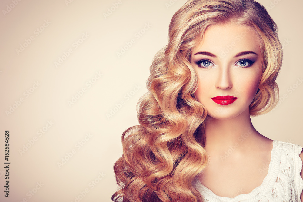 Fototapeta Fashion portrait of young beautiful woman with jewelry and elegant hairstyle. Blonde girl with long wavy hair. Perfect make-up.  Beauty style model