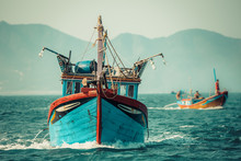 Fishing Boat Sailing On Water