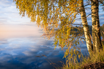 Obraz na Szkle Krajobraz Scenic landscape with lake and fall colors at morning light
