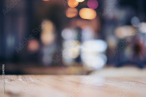 Fotografie, Obraz  Wooden table in cafe with blur bokeh abstract vintage background