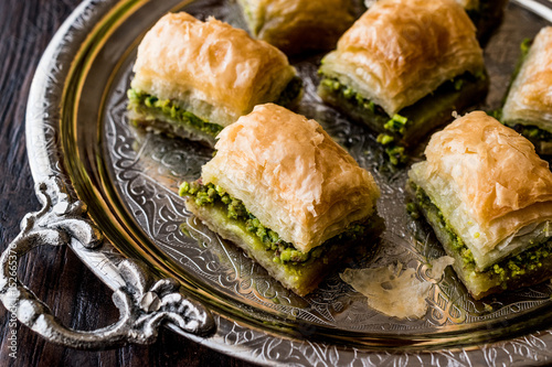 Turkish Dessert Baklava with pistachio on silver tray. Canvas Print