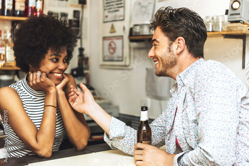 Fotografie, Tablou Male client flirting with female bartender