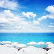 turquiose water of cote dAzur over white beach umbrellas, Nice France, retro toned