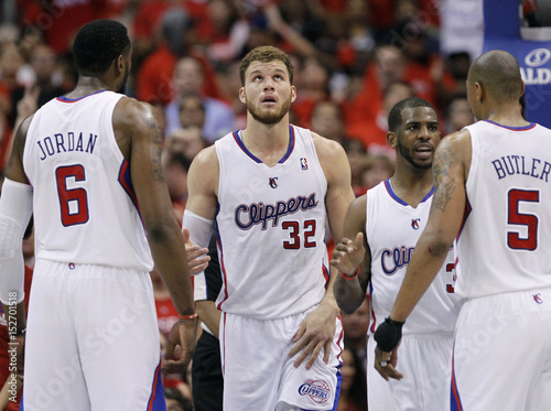 Clippers Blake Griffin looks up at the clock as he gathers