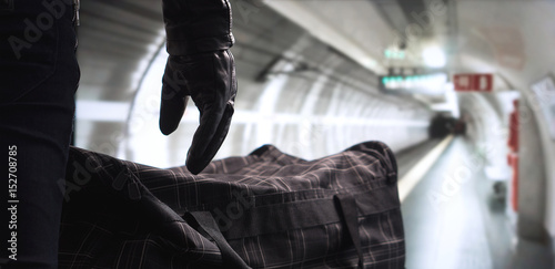 Fotografía  Terrorist and dangerous criminal in subway with suspicious black bomb bag