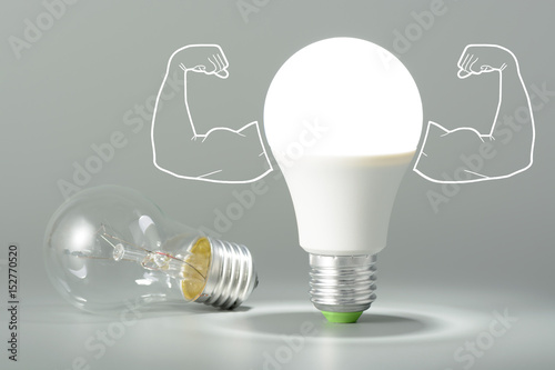 Fényképezés  Led light bulb with inflated arms and lay next to incandescent bulb