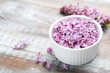 Lilac flowers in bowl on wooden table