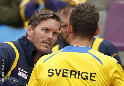 Sweden's team captain Enqvist talks to teammate Ryderstedt