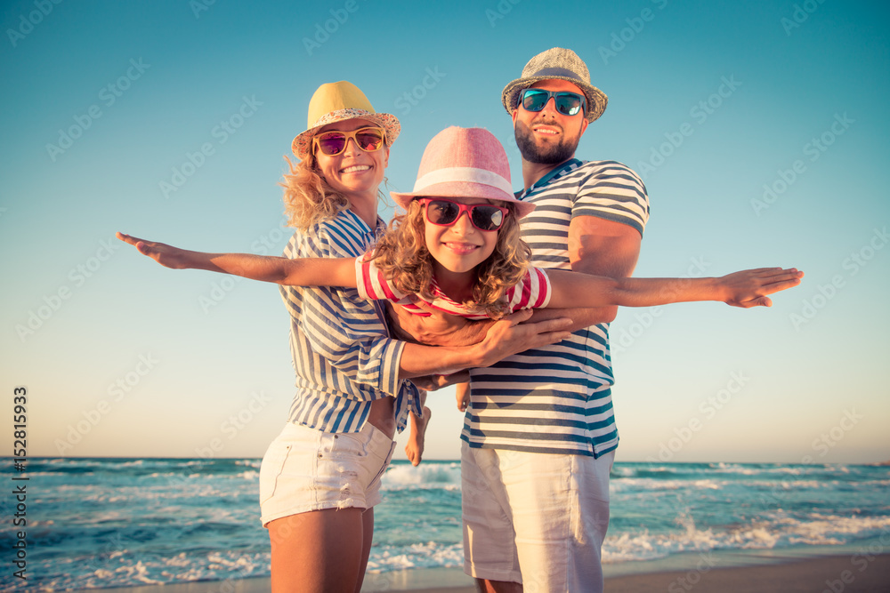 Fototapeta Happy family having fun on summer vacation
