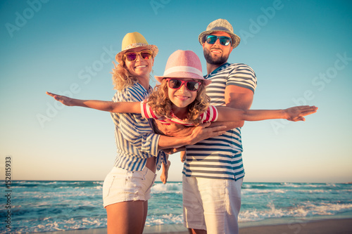 Obraz Happy family having fun on summer vacation - fototapety do salonu