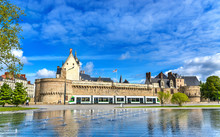 Castle Of The Dukes Of Brittany, A City Tram And The Water Mirror Fountain In Nantes, France
