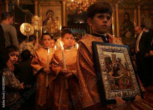 Palestinian Greek Orthodox worshipers attend Christmas