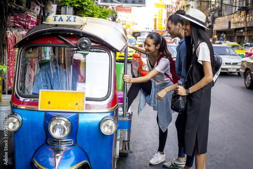 Fotografie, Obraz  Three asian girls are taking Tuktuk to travel around Chinatown, Thailand