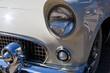 Headlights of a classic or retro car in a car shop